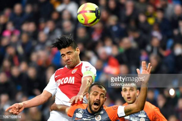 Monaco's Colombian forward Falcao heads the ball next to Montpellier's Brazilian defender Vitorino Hilton during the French L1 football match between...