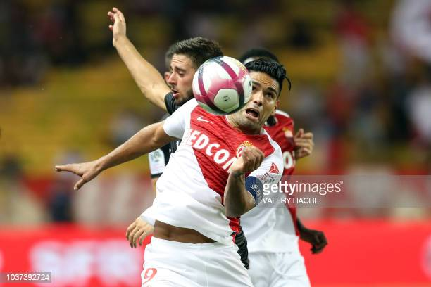 Monaco's Colombian forward Falcao vies for the ball with Nîmes' French midfielder Theo Valls during the French L1 football match between Monaco and...