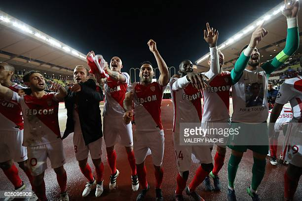Monaco's Colombian forward Radamel Falcao and his teammates celebrate after winning the UEFA Champions League group E football match AS Monaco and...