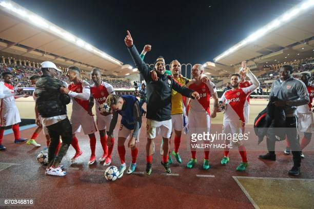 Monaco's Colombian forward Radamel Falcao and his teammates acknowledge the public after Monaco defeated Dortmund during the UEFA Champions League...