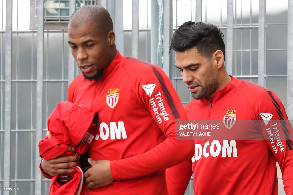 Monaco's Colombian forward Radamel Falcao (R) and Monaco's French defender Djibril Sidibe (L) arrive for a training session on March 29, 2018 at the training camp in La Turbie near Monaco. /