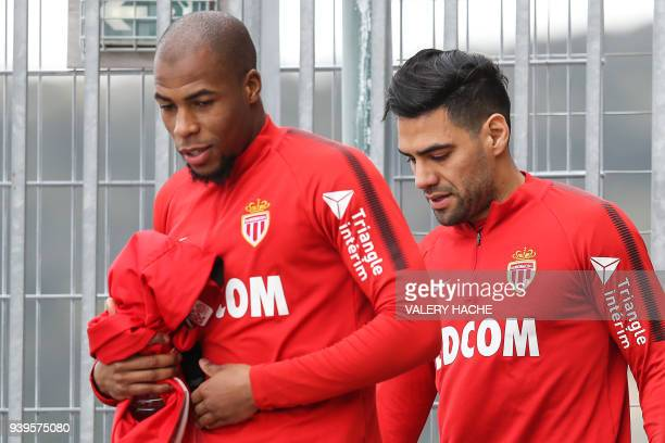 Monaco's Colombian forward Radamel Falcao and Monaco's French defender Djibril Sidibe arrive for a training session on March 29, 2018 at the training...