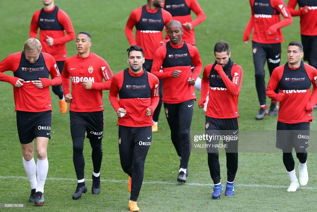 Monaco's Colombian forward Radamel Falcao (front row - 3rdL) and teammates run during a training session on March 29, 2018 at training camp in La Turbie near Monaco. /