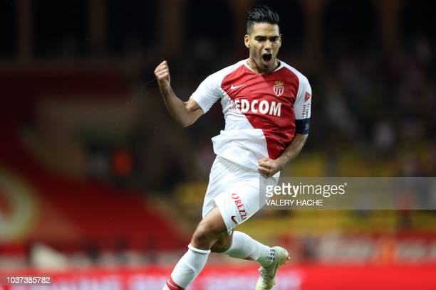 Monaco's Colombian forward Radamel Falcao celebrates after scoring a goal during the French L1 football match between Monaco and Nimes on September...