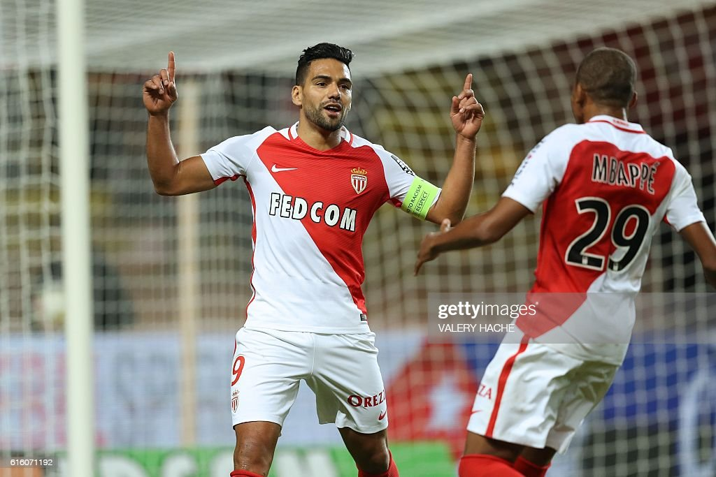 Monaco's Colombian forward Radamel Falcao (L) celebrates with French forward Kylian Mbappe after scoring a goal during the French L1 football match between AS Monaco and Montpellier at the Louis II Stadium in Monaco on October 21, 2016. / AFP / VALERY