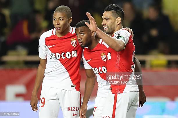 Monaco's Colombian forward Radamel Falcao celebrates with Monaco's French forward Kylian Mbappe and Monaco's French midfielder Thomas Lemar after...