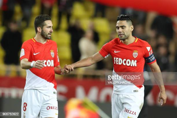 Monaco's Colombian forward Radamel Falcao celebrates with Monaco's Portuguese midfielder Jao Moutinho after scoring during the French L1 football...