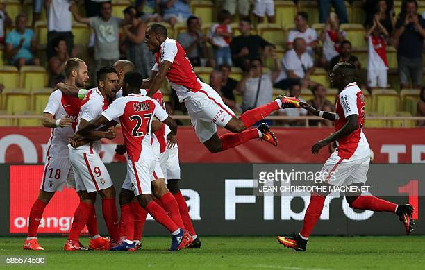Monaco's Colombian forward Radamel Falcao celebrates with teammates after scoring a goal during the Champions League Third qualifying round football...