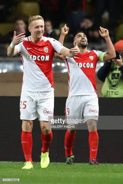Monaco's Colombian forward Radamel Falcao celebrates with teammates after scoring a goal during the French L1 football match between Monaco and Nice...