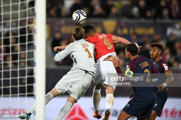 Monaco's Colombian forward Radamel Falcao heads the ball for a disallowed goal past Paris SaintGermain's German goalkeeper Kevin Trapp and Paris...