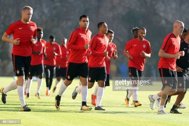 Monaco's Colombian forward Radamel Falcao Monaco's Italian defender Andrea Raggi and Monaco's Polish defender Kamil Glik attend a training session at...
