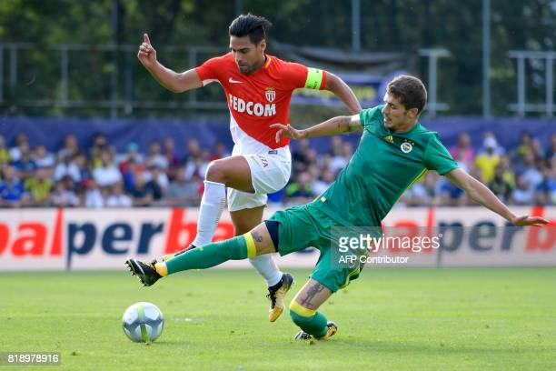 Monaco's Colombian forward Radamel Falcao outruns Fenerbahce's Russian defender Roman Neustadter during a friendly football match between AS Monaco...