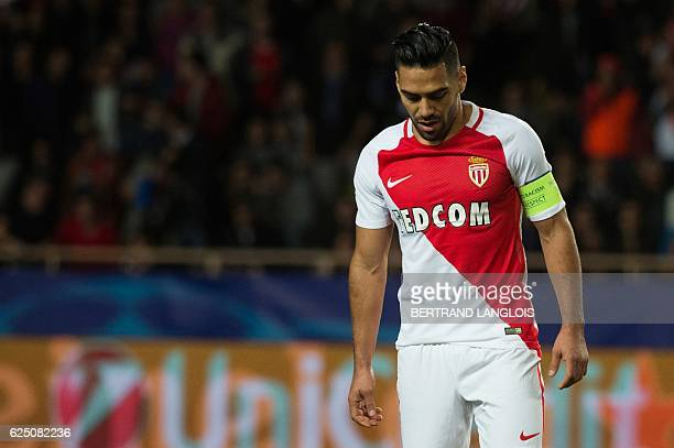 Monaco's Colombian forward Radamel Falcao reacts after missing a penalty kick during the UEFA Champions League group E football match AS Monaco and...