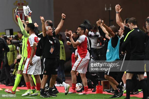 Monaco's Colombian forward Radamel Falcao reacts with teammates as they celebrate winning the French championship after winning the French L1...
