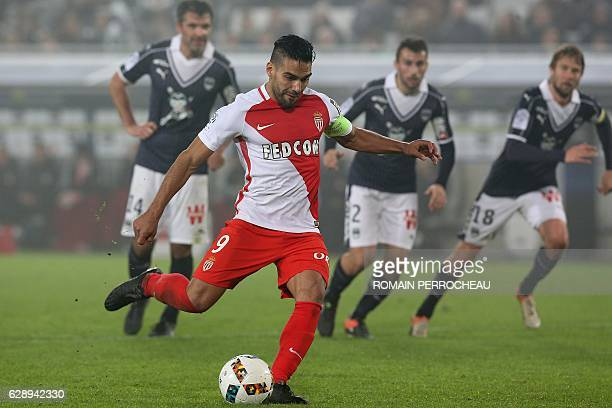 Monaco's Colombian forward Radamel Falcao scores a penalty kick during the French L1 football match Bordeaux vs Monaco on December 10 2013 at the...