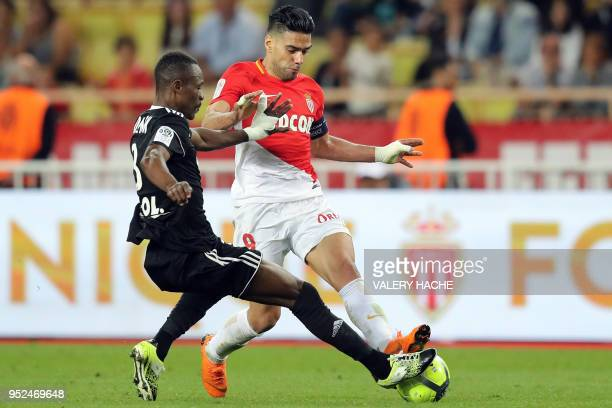 Monaco's Colombian forward Radamel Falcao vies with Amiens' French midfielder Guessouma Fofana during the French L1 football match between Monaco and...