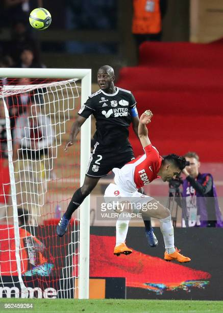 Monaco's Colombian forward Radamel Falcao vies with Amiens' Prince Desir Gouano during the French L1 football match Monaco vs Amiens on April 28 2018...