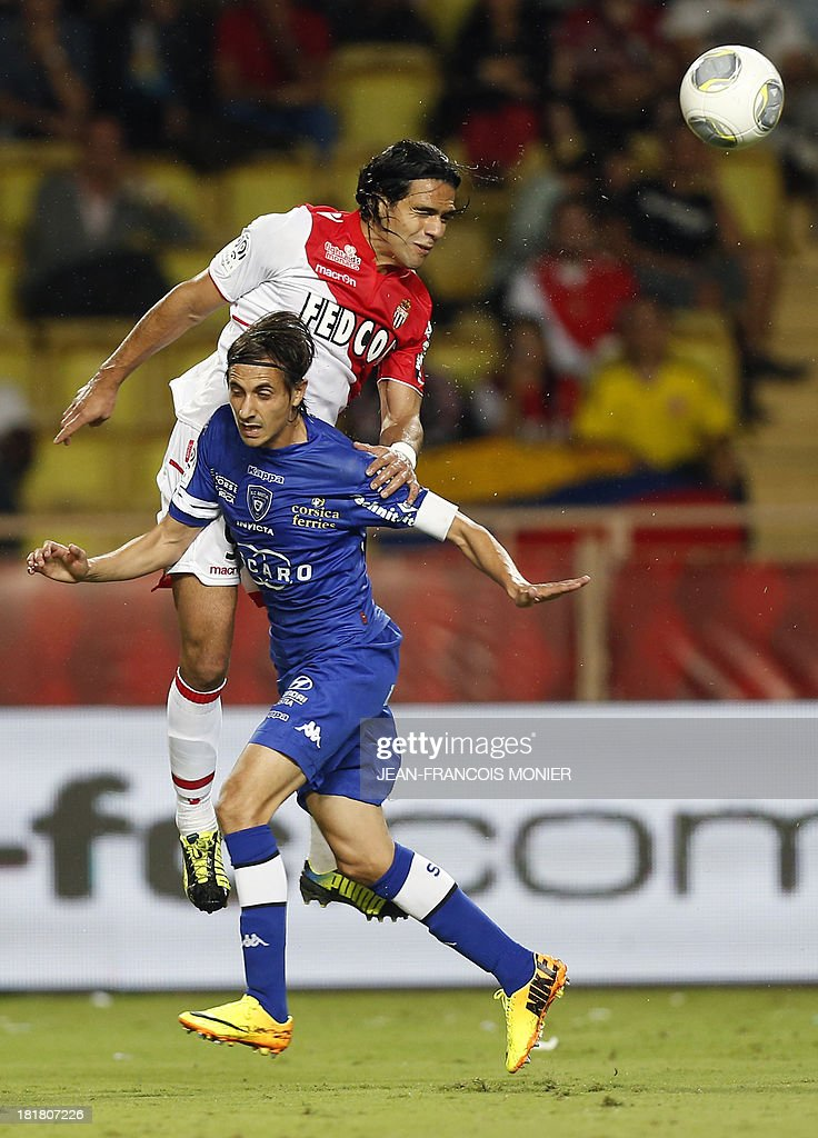 Monaco's Colombian forward Radamel Falcao (Up) vies with Bastia's Algerian defender Fethi Harek during their French Champions' Trophy basketball match Nanterre vs Paris-Levallois, on September 25, 2013 at The Vendespace in Mouilleron-le-Captif , Western France.