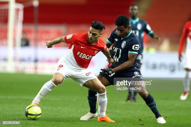 Monaco's Colombian forward Radamel Falcao vies with Lille's Brazilian forward Thiago Mendes during the French L1 football match Monaco vs Lille on...