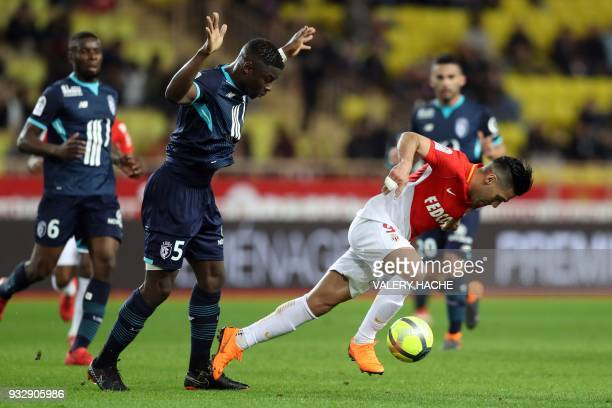 Monaco's Colombian forward Radamel Falcao vies with Lille's French defender Adama Soumaoro during the French L1 football match between Monaco and...