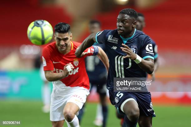 Monaco's Colombian forward Radamel Falcao vies with Lille's French defender Adama Soumaoro during the French L1 football match Monaco vs Lille on...