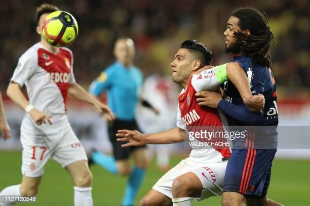 Monaco's Colombian forward Radamel Falcao vies with Lyon's defender Jason Denayer during the French L1 football match Monaco vs Lyon on February 24...