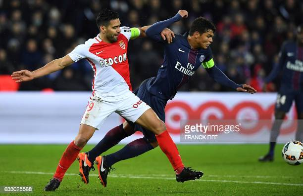 TOPSHOT Monaco's Colombian forward Radamel Falcao vies with Paris SaintGermain's Brazilian defender Thiago Silva during the French L1 football match...