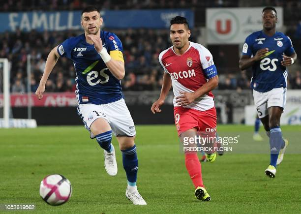 Monaco's Colombian forward Radamel Falcao vies with Strasbourg's Serbian defender Stefan Mitrovic during the French L1 football match between...