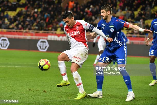 Monaco's Colombian forward Radamel Falcao vies with Strasbourg's Serbian defender Stefan Mitrovic during the french L1 football match AS Monaco vs...