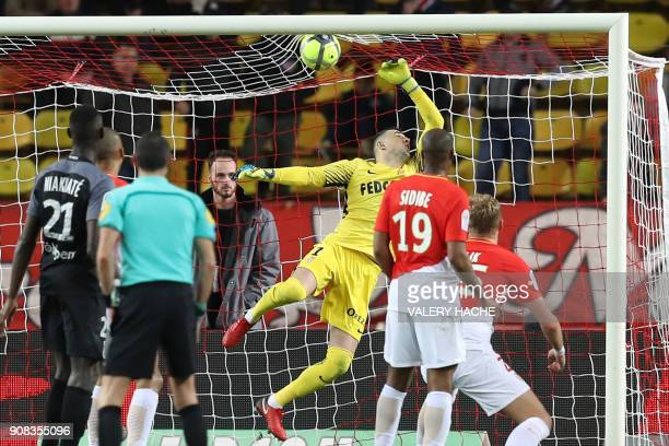 Monaco's Croatian goalkeeper Danijel Subasic fails to prevent Monaco's French midfielder Rachid Ghezzal from scoring a goal during the French L1...