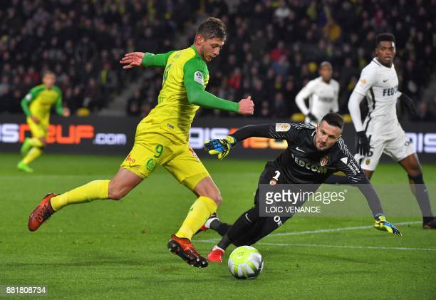 Monaco's Croatian goalkeeper Danijel Subasic vies with Nantes' Argentinian forward Emiliano Sala during the French L1 football match Nantes vs Monaco...