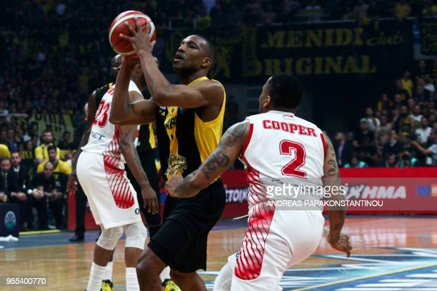AS Monaco's DJ Cooper vies with AEK Athen's Mike Green during the final four Champions League final basketball game between AS Monaco and AEK Athens...