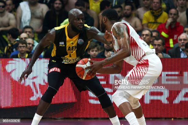 AS Monaco's Donell 'D J' Cooper vies for the ball with AEK's Delroy James during the final four Champions League final basketball game between AS...