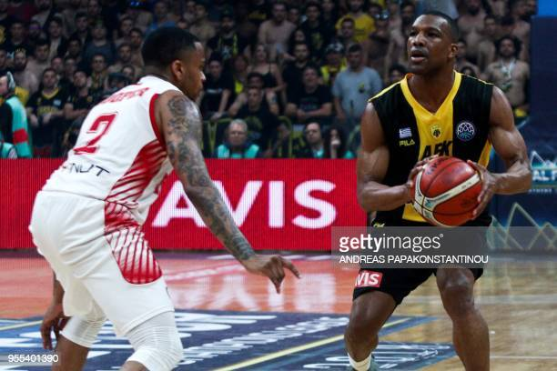 AS Monaco's Donell 'D J' Cooper vies for the ball with AEK's Mike Green during the final four Champions League final basketball game between AS...