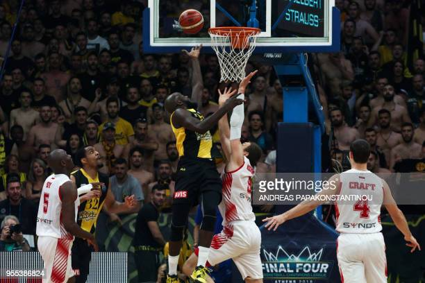 AS Monaco's Elemedin Kikanovic vies with AEK Athens Delroy James during the final four Champions League basketball 3rd place game between Riesen...