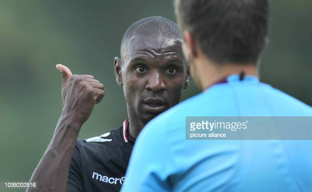 Monaco's Eric Abidal talks with the referee during the test match between FC Augsburg and AS Monaco in Memmingen Germany 20 July 2013 Photo...