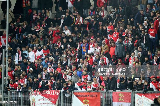 Monaco's fans stand during the French L1 Football match Amiens vs Monaco on November 17 2017 at the Licorne Stadium in Amiens in the tribune that...