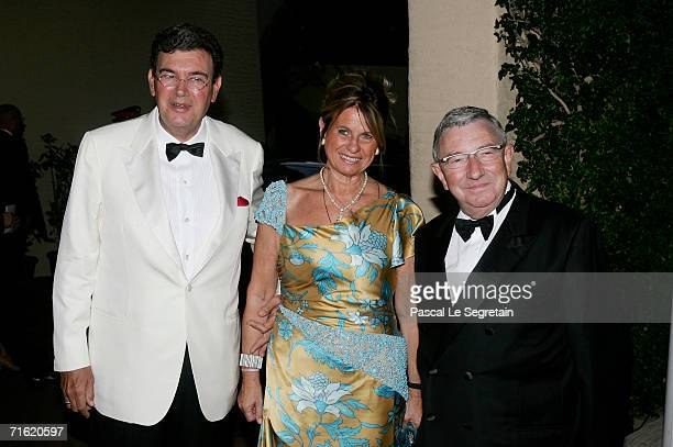 AS Monaco's football club president Michel Pastor unidentified guest and Monaco Minister of State JeanPaul Proust arrive at the Monaco Red Cross Ball...