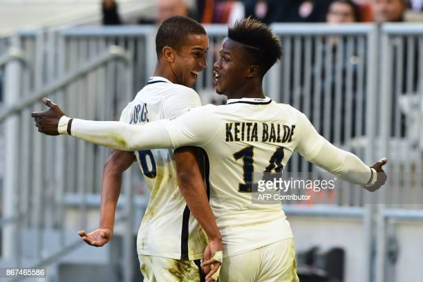 Monaco's forward Keita Balde celebrates after scoring a goal during the French L1 football match between Bordeaux and Monaco on October 28 2017 at...