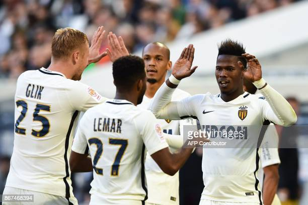 Monaco's forward Keita Balde celebrates with teammates after scoring a goal during the French L1 football match between Bordeaux and Monaco on...