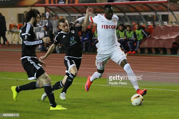 Monacos forward Lacina Traoré prior to the Qarabag's defender Ansi Agolli during their match at UEFA Europa League group J football