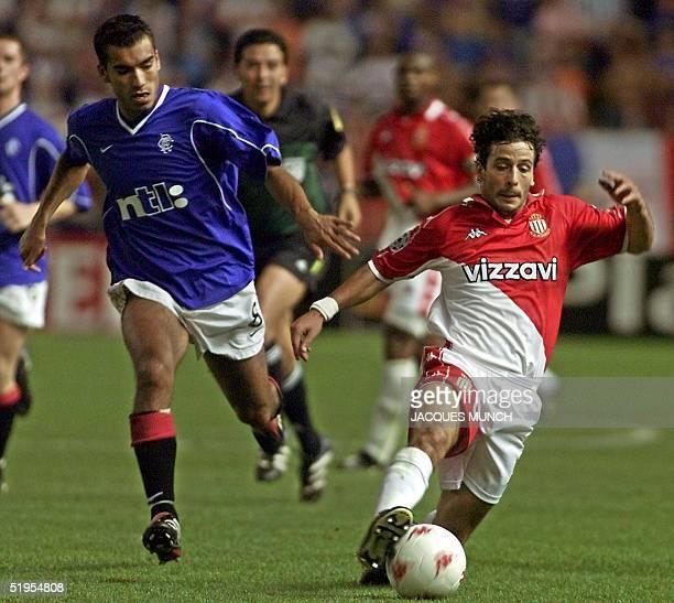 Monaco's forward Ludovis Giuly vies Glasgow Rangers midfielder Giovanni Van Bronckhorst 20 September 2000 in Monaco during the Champions League first...