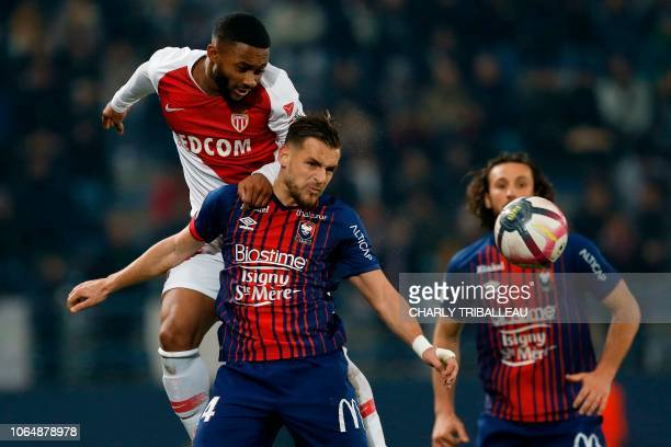 Monaco's forward Moussa Sylla vies with Caen's French defender Jonathan Gradit during the French L1 football match between Caen and Monaco on...