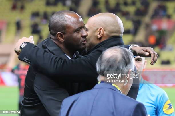 Monaco's French coach Thierry Henry and Nice's French head coach Patrick Vieira hug prior to the French L1 football match between Monaco and Nice on...
