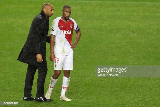Monaco's French coach Thierry Henry comforts Monaco's French defender Djibril Sidibe after being defeated 4-0 by Brugge at the end of the UEFA...