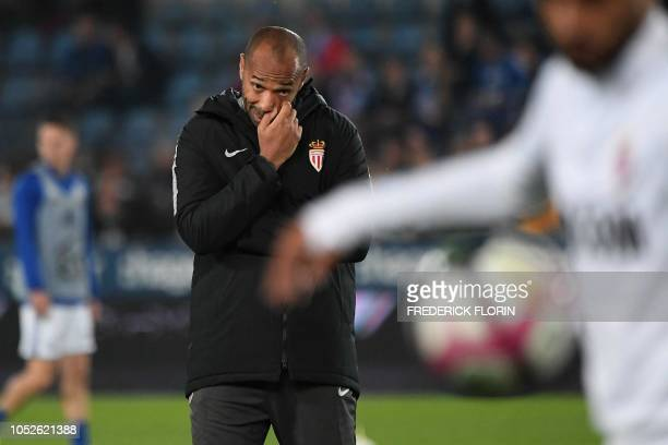 TOPSHOT Monaco's French coach Thierry Henry gestures before the French L1 football match between Strasbourg and Monaco at the Meinau stadium in...