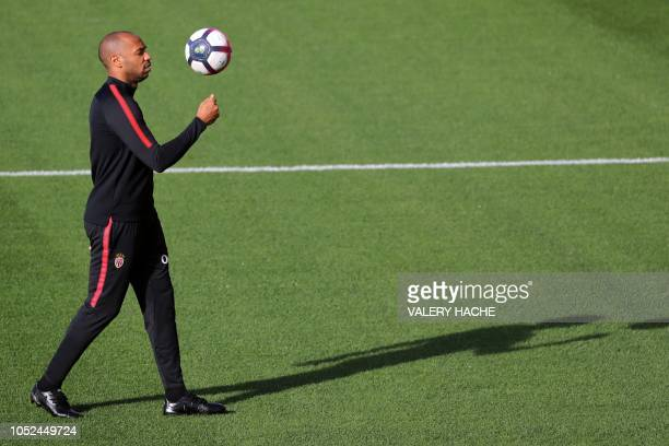 Monaco's French coach Thierry Henry walks on the pitch during a training session in La Turbie, near Monaco on October 18, 2018. - The 41-year-old...