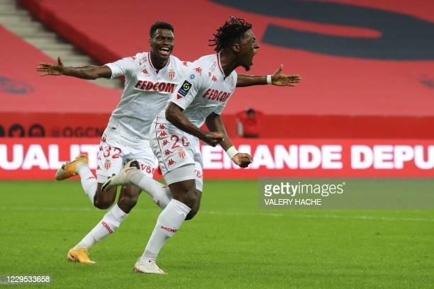 Monaco's French defender Axel Disasi celebrate after scoring a goal with Monaco's French defender Benoit Badiashile during the French L1 football...