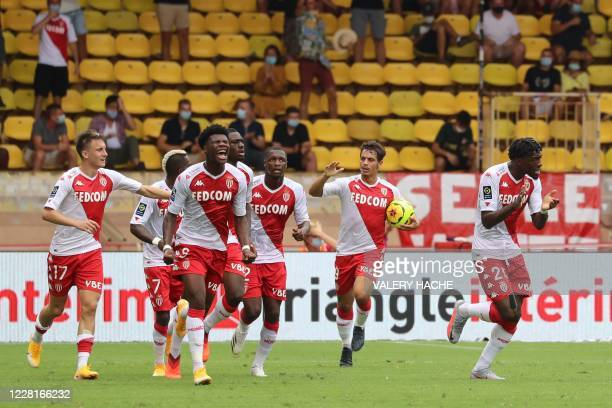 Monaco's French defender Axel Disasi is congratulated by teammates after scoring a goal during the French L1 football match between AS Monaco and...