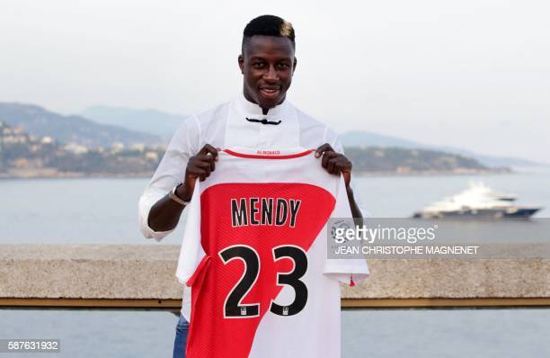 Monaco's French defender Benjamin Mendy poses with his jersey after a press conference on August 9 in Monaco / AFP / JEAN CHRISTOPHE MAGNENET